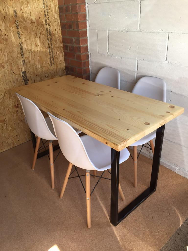 Handmade scaffold board dining table and four eiffel chairs delivery available