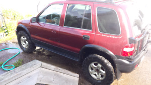 LIFTED 2000 kia sportage ex.