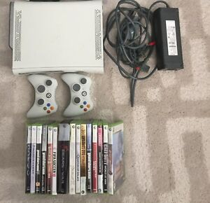 Xbox 360 premium console, two controllers and games