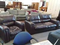 Brown leather suite featuring large pouffe. Delivery available