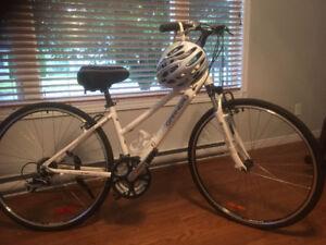 vélo de marque Louis Garneau avec casque meme marque neuf jo
