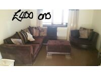 Corner couch, fridge freezer and other household items for sale