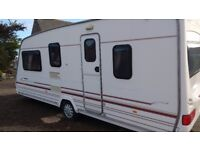 5 berth caravan , excellent holidays only resson selling we bought camper van £1800