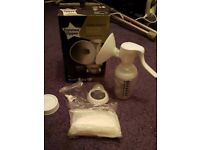 Tommee Tippee Breast pump with accessories.