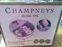Luxury foot spa with moving pedicure system and massage rollers