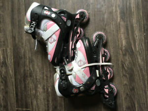 Two pairs of girls roller blades