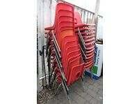 27 x Stacking Bucket Chairs Red Plastic with Metal Legs Office Event