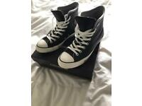 Converse leather trainers.