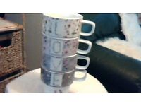 set of 4 mugs from NEXT splelling LOVE when stacked together vgc