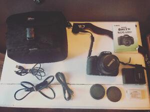 Canon EOS Rebel T3i 18.0MP Digital SLR Camera + Tripod + Case