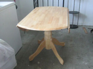 Light colour wood table no chairs for 40 dollars few scratches