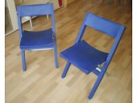 Two plastic chairs, foldable