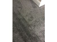 2.9m x 1.28m (at smallest point) grey carpet offcut.