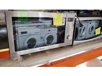 Stainless Steel Swan microwave in good working order and condition as well