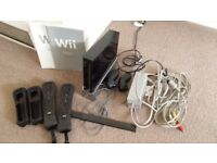 Wii bundle including console, controllers,fit board, games, mike etc