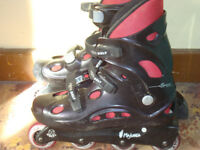 two pairs of inline skates sizes 7 and 9
