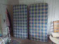 Two single mattresses