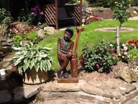 Wooden golfer statue ornament