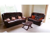 Leather sofas - 3 seater and 2 seater with footstool.