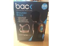 BRAND NEW Bac shoulder brace, hasn't left the box! Small-Medium, reduces pain and improves posture.