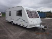2005 COMPASS OMEGA 544 FIXED BED 4 BERTH CARAVAN WITH NEW MOTOR MOVER ANDERSON CARAVAN SALES.