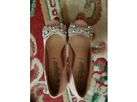 Cinderella shoes peachy pink with dimonte bows.