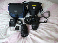 Nikon D3100 + Extra lens and accessories