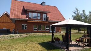 Chalet style house with 9.7 acres