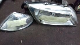 Pair of Ford Transit side mirrors (2005) model. Pair of front Headlamps with indicator lens (2002) .