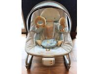 Soft suedette pastel coloured duckling baby bouncer