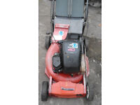 Husqvarna Lawnmower and grass box.