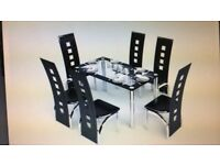 Glass Table and 6 black faux Leather Chairs - NEW - STILL IN BOX - £100