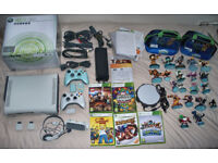 boxed xbox 360 with 2 controllers, games and skylanders!!!!