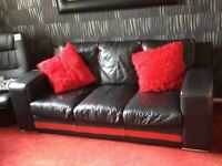 Black and red Leather 3 seat sofa with 2 large footstools