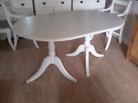 Oval dining table painted with Annie Sloan old white paint