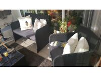 Rattan two seater chair and two one seater chairs and a glass top table also a matt if you want