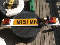 Towing tail board