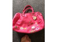 Pink handbag with motifs on