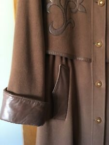 Long brown winter coat with leather embellishments