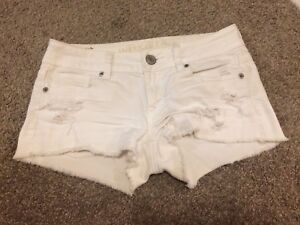 American Eagle White Ripped Short Shorts (size 0)