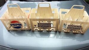 3 Kitchener Beverages bottle carriers.
