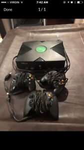 Black Xbox console with Controllers