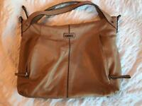 The Catherine Leather changing bag from Storksak in Almond