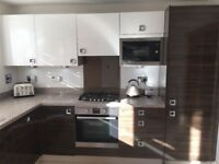 High gloss manhattan fitted kitchen including SOME appliances