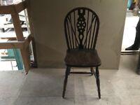 Hardwood wheel back chair