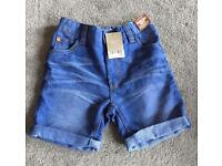 Girls BRAND NEW Next blue denim shorts (age 7 years)