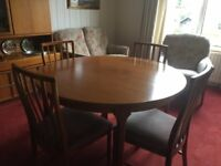 McIntosh round teak round dining table and 4 chairs. In very good condition.