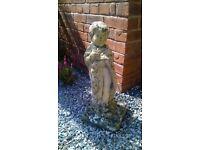 Garden stone statue of a boy
