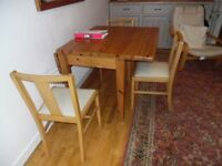 Drop leaf dining table & 3 upholstered chairs