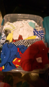 Bin of name brand baby clothes